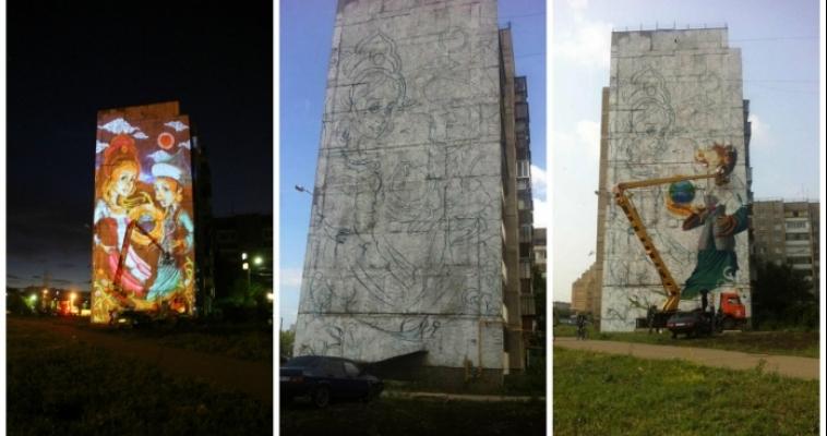 Земной шар и девушки в национальных костюмах. Художники приступили к оформлению фасада на Тевосяна